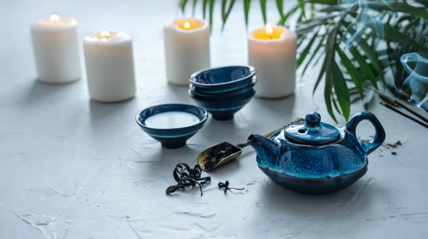 blue-tea-set-chinese-tea-ceremony-burning-candles-scented-couples_138888-403
